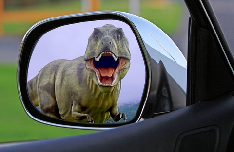 t-rex in the rearview mirror